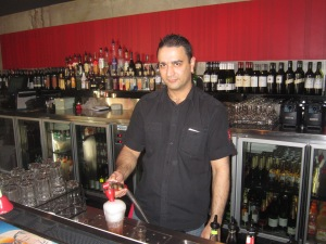 Ruzbeh serving drinks at Ribs and Rumps