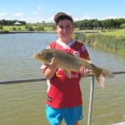 boy holding carp