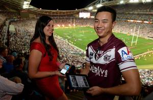 Fans on tablet and phone at ANZ Stadium