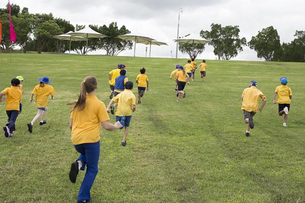 children running up hill