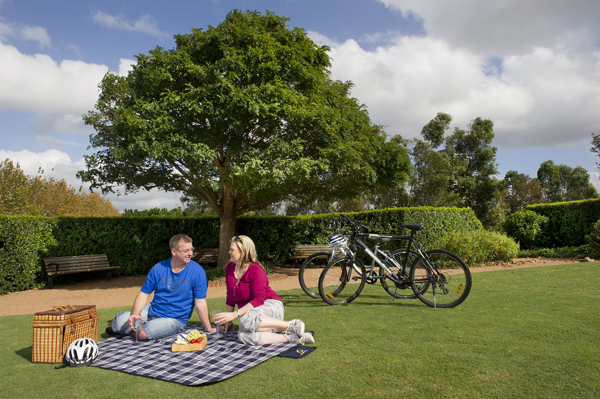 Couple on picnic blanket in parklands