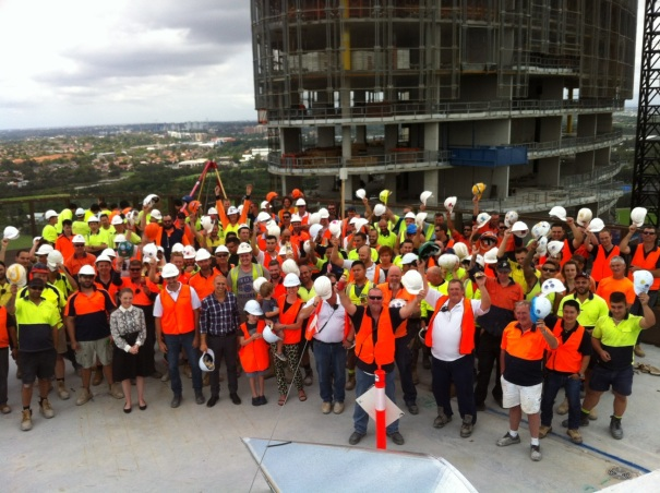 Construction workers with vegemite and sauce bottle