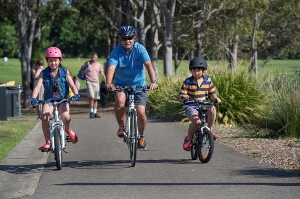 People bike riding in Bicentennial Park