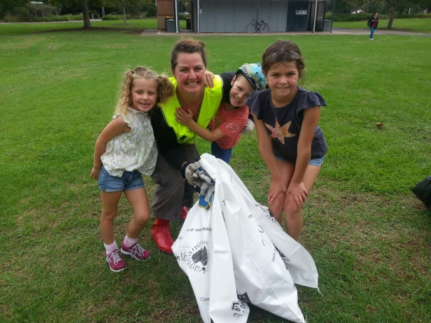 Mother and children with bags of rubbish at Clean Up Australia Day
