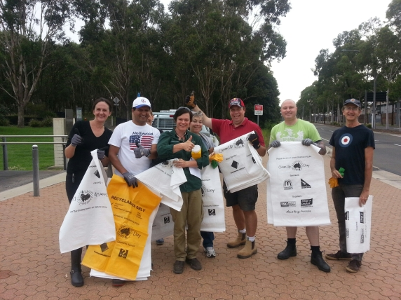 Group holding clean up australia day bags