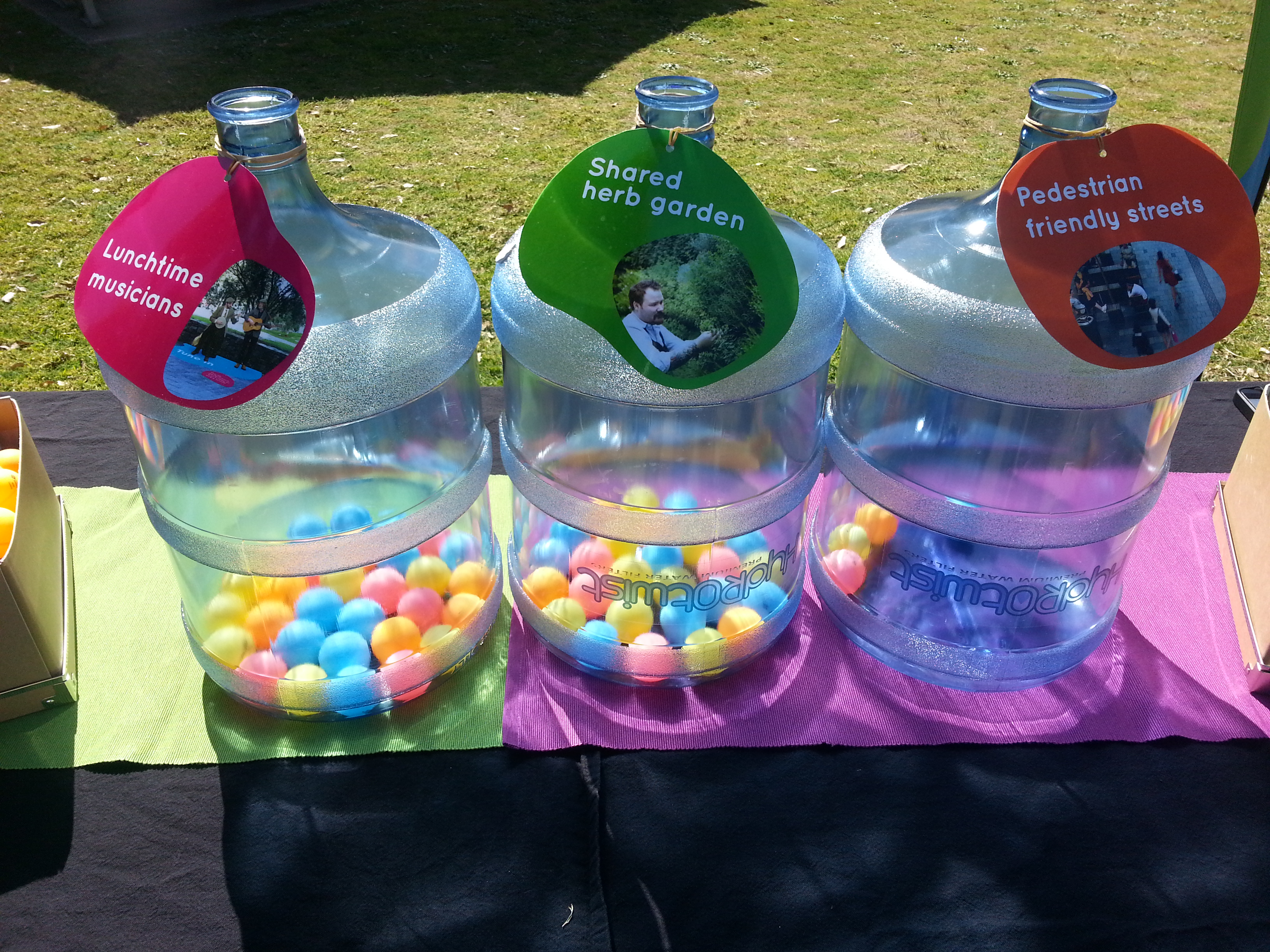 Water Bottles With Table Tennis Balls Showing Voting System